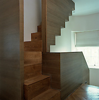 A timber staircase has been constructed along simple sculptural lines creating an interesting geometric silhouette
