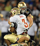 Aaron Lynch (19) and Manti Te'o combine to sack Florida State Seminoles quarterback EJ Manuel (3).