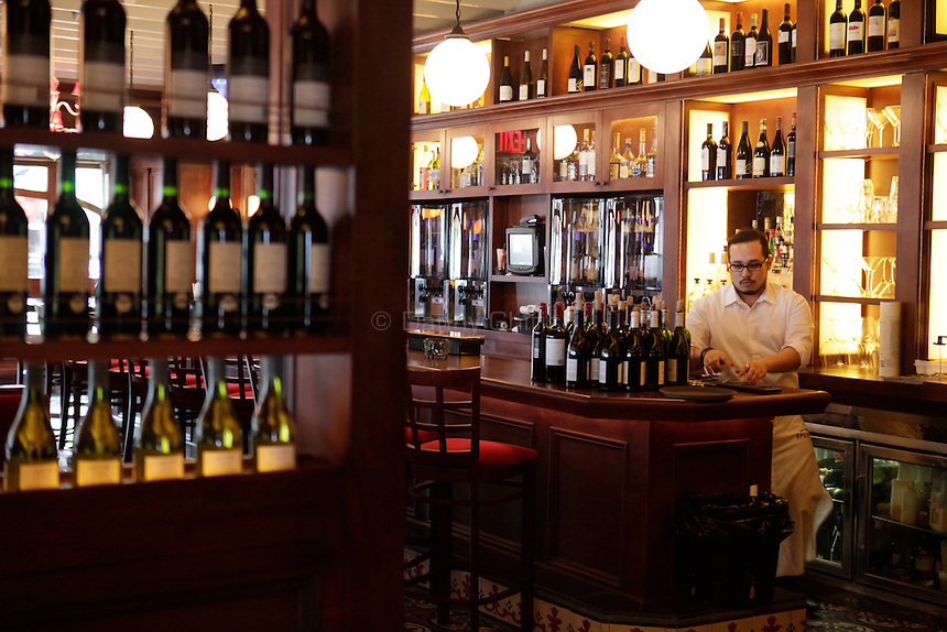 Jonathan Gonzales is a server at Aperiti, a French bistro in Rockville Centre that specialzes in small dishes and wines. .(October 15, 2010).Photo by Danny Ghitis