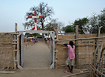 A girl watches through the fence as catechism class takes place inside the Catholic compound in Agok, in the contested Abyei region on the border between Sudan and South Sudan, where more than 100,000 Dinka Ngok fled in 2011 after attacks by northern soldiers and militias. The Catholic parish of Abyei, with support from Caritas South Sudan and other international church partners, has maintained its pastoral presence among the displaced and assisted them with food, shelter, and other relief supplies.