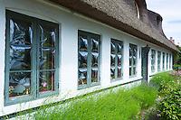 Convex glass windows of thatched cottage at Trofense off Svendborg, part of South Funen Archipelago, Denmark