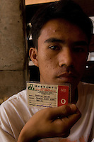 Sixteen year-old Jeffery Avila, shos his blood type card. Jeffery is in the line-up to donate his kidney and recieve a fee of about 90,000 pesos. Men from the Basico port area slum of Manilasell their kidney's for between 70,000 -  90,000 pesos (800 - 1030 pounds).  More than 300 have sold their kidneys in this slum of 16,000 people.<br /> <br /> PHORO BY RICHARD JONES