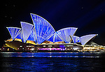 The Sydney Opera House  illuminated in colours during the Vivid Light Festival.