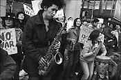 Musicians play their instruments to give encouragement to anti-America and anti-Iraqi war demonstrators marching through the streets, Tokyo, Japan