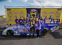 Sep 25, 2016; Madison, IL, USA; NHRA funny car driver Jack Beckman celebrates with Terry Chandler and crew after winning the Midwest Nationals at Gateway Motorsports Park. Mandatory Credit: Mark J. Rebilas-USA TODAY Sports