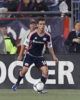 New England Revolution midfielder Diego Fagundez (14) dribbles down the wing. In a Major League Soccer (MLS) match, the New England Revolution (blue) tied New York Red Bulls (white), 1-1, at Gillette Stadium on May 11, 2013.