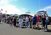Jun. 2, 2012; Englishtown, NJ, USA: NHRA fans wait in long lines to talk to and get autographs from top fuel dragster drivers Khalid Balooshi, Shawn Langdon, Brandon Bernstein and Morgan Lucas as well as funny car drivers. Jeff Arend, Alexis DeJoria, Tony Pedregon and Cruz Pedregon at the Toyota display during qualifying for the Supernationals at Raceway Park. Mandatory Credit: Mark J. Rebilas-