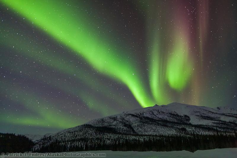 Aurora borealis over the Brooks range mountains, arctic, Alaska.