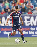 New England Revolution forward Benny Feilhaber (22) brings the ball forward. In a Major League Soccer (MLS) match, the New England Revolution tied the Columbus Crew, 0-0, at Gillette Stadium on June 16, 2012.