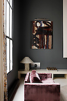 An abstract painting by Herve Half and a club armchair covered in violet silk velvet decorate the living room