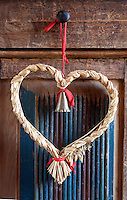 Detail of a straw heart-shaped Swedish Christmas decoration