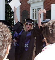 School of Nursing student Janet Farrington celebrates as she makes her way down the steps of the Rotunda during the 2006 gradution ceremonies Sunday May 21, 2006 at the University of Virginia in Charlottesville, Va. Photo/Andrew Shurtleff