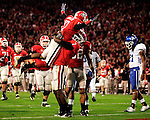 Georgia freshman Rantavious Wooten celebrates with UGA freshman Orson Charles after scoring a touchdown for the Bulldogs during their game against UK on Saturday, Nov. 21, 2009 at Sanford Stadium in Athens, Ga. The Cats were down 20-6 at the half against the Bulldogs.