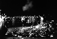 Thousands of books smoulder in a huge bonfire as Germans give the Nazi salute during the wave of book-burnings that spread throughout Germany.  1933.  INP.  (OWI)<br /> Exact Date Shot Unknown<br /> NARA FILE #:  208-N-39840<br /> WAR &amp; CONFLICT BOOK #:  986