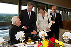 September 29, 2011; Rev. Theodore M. Hesburgh, C.S.C., chats with Dr. Horst Koehler, former President of the Federal Republic of Germany, wife, Eva Luise Koehler and Professor Vittorio Hosle (right) before dinner in the 14th floor penthouse of the Hesburgh Library. Photo by Barbara Johnston/University of Notre Dame