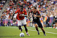 Nick LaBrocca (6) of the MLS All-Stars is trailed by Mame Biram Diouf (32) of Manchester United. Manchester United defeated the MLS All-Stars 4-0 during the MLS ALL-Star game at Red Bull Arena in Harrison, NJ, on July 27, 2011.