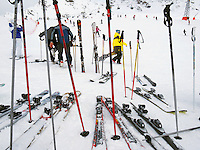 "Switzerland. Canton Valais. Si tourists in Verbier at  "" La Chaux"" ( 2260 meters ). Verbier is a village located in the municipality of Bagnes in the Val de Bagnes. Verbier is one of the largest holiday resort and ski areas in the Swiss Alps. Ski poles and skis. 3.01.2012 © 2012 Didier Ruef"