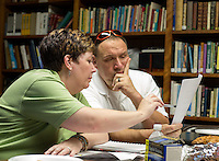 STAFF PHOTO JASON IVESTER --08/19/2014--<br /> Janice and Tim Shanahan, both of Rogers, look over the Welsh alphabet during a Welsh class on Tuesday, Aug. 19, 2014, inside St. Andrew's Episcopal Church in Rogers.