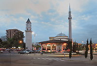 The Et'hem Bey Mosque or Xhamia e Et'hem Beut, begun 1789 by Molla Bey and finished in 1823 by his son Haxhi Ethem Bey, great-grandson of Sulejman Pasha, and on the left, the Clock Tower of Tirana or Kulla e Sahatit, 35m high, built in 1822 by Haxhi Et'hem Bey, Tirana, Albania. The mosque is listed as a Cultural Monument of Albania. Tirana was founded by the Ottomans in 1614 by Sulejman Bargjini and became the capital of Albania in 1920. Picture by Manuel Cohen