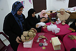 Aisha al-Baroud, 44, a Palestinian woman with breast cancer and her colleagues make artificial breasts for mastectomy survivors for free, in the northern Gaza stirp on Feb. 13, 2017. Al-Baroud with breast cancer for more three years and she dosen't completed her treatment in Israeli hospitals because Israeli rejection. according health information center, breast cancer comes first By 17.8% of total cancer cases in Gaza strip. Photo by Khaled Abu Alouf