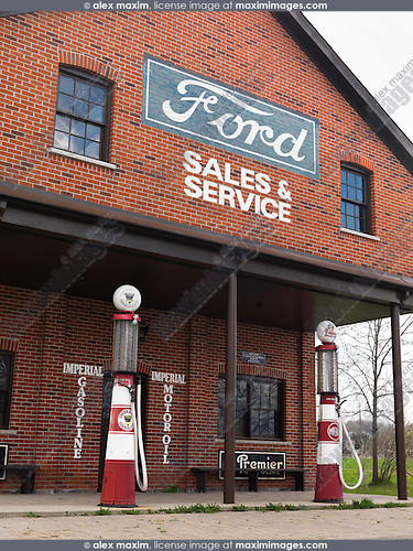 Imperial Gasoline vintage gas station with Ford sales and services sign on it. Ontario Canada.
