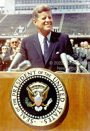 """United States President John F. Kennedy speaks before a crowd of 35,000 people at the Rice University football field in Houston, Texas on September 12, 1962.  The following are excerpts from his speech. """" ...We set sail on this new sea [space] because there is a new knowledge to be gained, and new rights to be won, and they must be won and used for the progress of all people. ...Whether it will become a force for good or ill depends on man, and only if the United States occupies a position of pre-eminence can we help decide whether this new ocean will be a sea of peace or a new terrifying theater of war. But I do say space can be explored and mastered without feeding the fires of war, without repeating the mistakes that man has made with extending his writ around this globe of ours. ...There is no strife, no prejudice, no national conflict in outer space as yet. Its conquest deserves the best of all mankind, and its opportunity for peaceful cooperation may never come again. But why, some say the Moon? Why choose this as our goal? And they may well ask, why climb the highest mountian? Why - 35 years ago - why fly the Atlantic? Why does Rice play Texas? We choose to go to the Moon, we choose to go to the Moon in this decade and do the other things, not because they are easy, but because they are hard, because that goal will serve to organize and measure the best of our energies and skills, because that challenge is one that we are willing to accept, one we are unwilling to postpone, and one in which we intend to win, and the others too..Credit: NASA via CNP"""