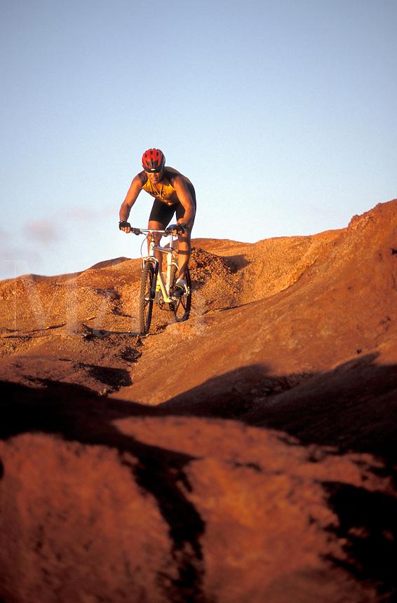 USA, Hawaii, Kauai, mountain biker descends ridge.  MR available<br />