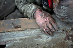 The body of a man killed during the March 11 earthquake and tsunami lies in the shattered remains of a community hit my the March 11 tsunami in Ishinomaki, Japan on 15 March, 2011.  Photographer: Robert Gilhooly
