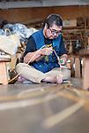 Ichiro Iwao splits strips of bamboo to make baskets at Iwao Chikuran's workshop in Beppu City, Oita Prefecture, Japan on Sept. 20. 2016.  ROB GILHOOLY PHOTO