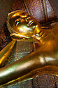 The Reclining Buddha at Wat Pho, the largest Buddhist temple in Bangkok, Thailand, and birthplace of Thai massage.