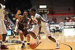 Mississippi's Nick Williams (20) drives against Arkansas Little Rock's Ben Dillard (24) at the C.M. &quot;Tad&quot; Smith Coliseum in Oxford, Miss. on Friday, November 16, 2012. (AP Photo/Oxford Eagle, Bruce Newman)