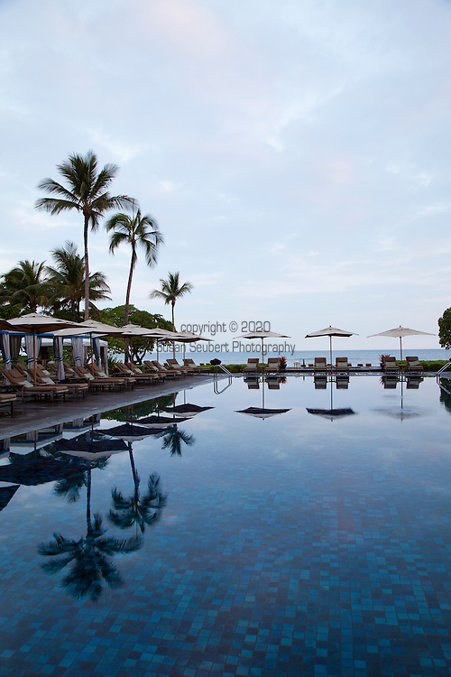 The Four Seasons Resort Hualalai at Historic Kaupulehu on the Big Island of Hawaii. The Beach Tree Pool at sunrise.