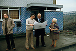 GERRY FITT WITH BODYGUARD LOOKING AT PLANS FOR A NEW ROAD TO RUN PAST THE UNITY FLATS BELFAST, Sir Gerry Fitt, founder of the SLDP and MP for West Belfast,