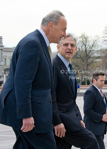 United States Senator Chuck Schumer (Democrat of New York), right, leads Judge Merrick Garland, chief justice for the US Court of Appeals for the District of Columbia Circuit, who is US President Barack Obama's selection to replace the late Associate Justice Antonin Scalia on the US Supreme Court, left, walk up the steps into the US Capitol following a photo op in Washington, DC on Tuesday, March 22, 2016.   <br /> Credit: Ron Sachs / CNP<br /> (RESTRICTION: NO New York or New Jersey Newspapers or newspapers within a 75 mile radius of New York City)