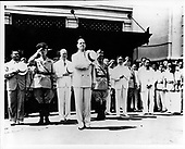 Manila, Philipines - Undated file photo -- Colonel Dwight D. Eisenhower, to the left and behind General Douglas MacArthur, view a parade in Manila, Philippines in 1919..Credit: U.S. Army / CNP