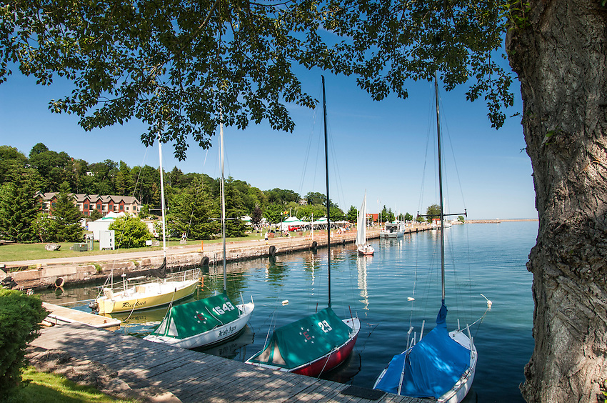 Sailboats on a sunny day along the Lake Superior shoreline and parks of Marquette, Michigan.