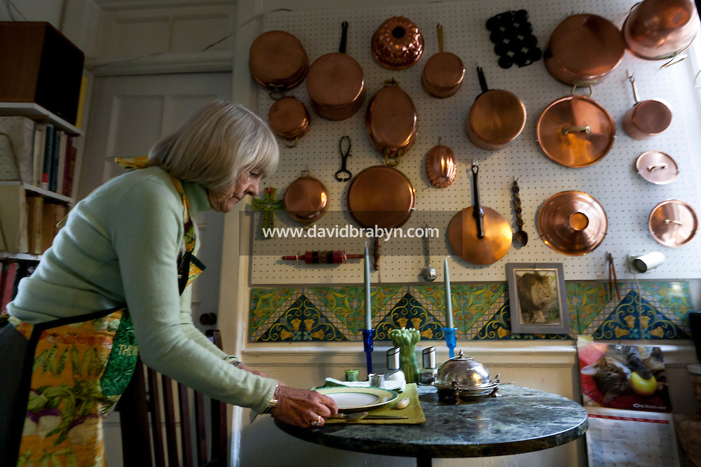 Book editor and author Judith Jones lays the table for her meal in her apartment in New York City, USA, 2 October 2009.
