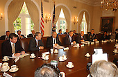 United States President George W. Bush meets National Security Advisors in the Cabinet Room of the White House in Washington, D.C. to develop a stratrgy for responding to the terrorist attacks in New York and Washington on Wednesday, September 12, 2001.  Left to right: Attorney General John Ashcroft; Secretary of Defense Donald Rumsfeld; Secretary of State Colin Powell; President Bush; Vice President Dick Cheney; Chairman of the Joint Chiefs of Staff Henry Shelton; and National Security Advisor Condolezza Rice..Credit: Ron Sachs / CNP