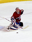 23 October 2006: Montreal Canadiens goalie Cristobal Huet (39) makes a stick save in the second period of play against the Montreal Canadiens at the Bell Centre in Montreal, Canada. The Sabres defeated the Canadiens 4-1 to increase their season-opening winning streak to 9 games. Mandatory photo credit: Ed Wolfstein Photo.<br />  *** Editorial Sales through Icon Sports Media *** www.iconsportsmedia.com
