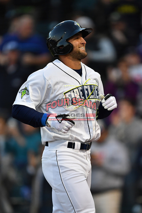 Left fielder Tim Tebow (15) of the Columbia Fireflies smiles after hitting a home run in his first Class A at bat in a game against the Augusta GreenJackets on Opening Day, Thursday, April 6, 2017, at Spirit Communications Park in Columbia, South Carolina. (Tom Priddy/Four Seam Images)