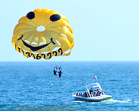 Parasailers come in for a landing aboard Marina Del Rey Parasailing on Wednesday, May 30, 2012.