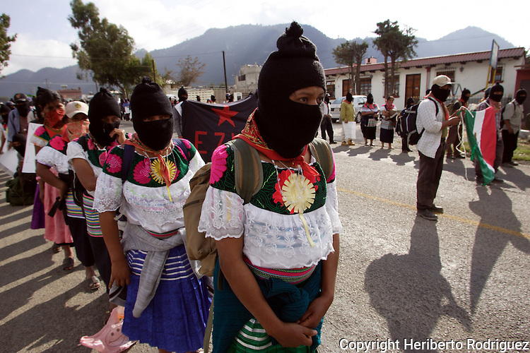 Zapatista Indian peasants march in San Cristobal de las Casas while Subcomandante Marcos heads the rally starting a six-month tour all over Mexico, January 1st. 2006. Marcos started The Other Campaign to meet people and organizations to promote an anti-capitalism and anti-neoliberal program. The Zapatistas launched an uprising twelve years ago demanding better living conditions for the Indian people in Mexico. Photo by Heriberto Rodriguez ....