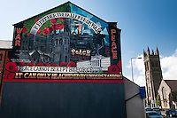 Belfast, Northern Ireland, United Kingdom, May 2011. Colourful murals with militaristic images are the silent reminders of the sectarian violence. During The Troubles, the Greater Shankill and its residents were subjected to bombings and shootings by Irish republican paramilitary forces, the most notable of which was the Shankill Road bombing. The Shankill was also a centre for loyalist paramilitarism. The modern Ulster Volunteer Force (UVF) had its genesis on the Shankill. Similarly the Ulster Defence Association, established in September 1971, also began on the Shankill. For decades travellers stayed away from the sectarian violence, but since the end of'The Troubles' more and more people start discoving the beauty of Belfast and the Antrim Coast Causeway. Photo by Frits Meyst/Adventure4ever.com
