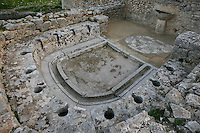 High angle view of the public lavatories in the Baths of the Cyclopes, 3rd century, in Dougga, Tunisia, pictured on January 31, 2008, in the afternoon.  Dougga has been occupied since the 2nd Millenium BC, well before the Phoenicians arrived in Tunisia. It was ruled by Carthage from the 4th century BC, then by Numidians, who called it Thugga and finally taken over by the Romans in the 2nd century. Situated in the north of Tunisia, the site became a UNESCO World Heritage Site in 1997. Picture by Manuel Cohen.