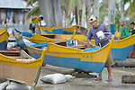 Men paint new fishing boats on Jinamoc Island, part of the municipality of Basey in the Philippines province of Samar that was hit hard by Typhoon Haiyan in November 2013. The storm was known locally as Yolanda, and left most of the island's boats, nets, and houses destroyed.  The community received some new boats from the government, and material for new nets from a media conglomerate. The ACT Alliance has been providing a variety of assistance to survivors, including cash for work and temporary housing, and is planning a long-term rehabilitation program with residents that will include permanent housing, schools, agricultural development, and water and sanitation facilities.