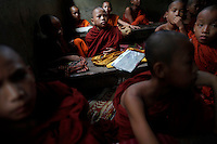 Myanmar's ethnic Karen novice monks attend a class in their monastery in Mae La refugee camp outside Mae Sot near the Thai-Myanmar border October 14, 2010. Ethnic Karen refugees continue to pour into Thailand, fleeing decades long fighting between Karen rebels and Myanmar government troops and its guerrilla allies. Some 140,000 refugees live in official camps along the Thai-Myanmar border, according to the U.N. refugee agency and there are concerns that hostilities in the hills of Eastern Myanmar could intensify as a result of a refusal of several ethnic political groups to take part in an election next month.     REUTERS/Damir Sagolj (THAILAND)