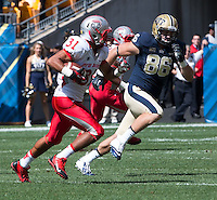 New Mexico safety Dante Caro (31) returns a first quarter interception. The Pitt Panthers defeated the New Mexico Lobos 49-27 on Saturday, September 14, 2013 at Heinz Field, Pittsburgh, Pennsylvania.