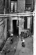 Bronx, New York City, NY. Summer of 1966.<br /> Kid playing baseball in courtyard.<br /> From the mid-1960s to the late-1970s, quality of life for Bronx residents declined sharply.