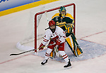 ST CHARLES, MO - MARCH 19:  Sydney McKibbon (11) of the Wisconsin Badgers jockeys for position on front of Shea Tiley (35) of the Clarkson Golden Knights during the Division I Women's Ice Hockey Championship held at The Family Arena on March 19, 2017 in St Charles, Missouri. Clarkson defeated Wisconsin 3-0 to win the national championship. (Photo by Mark Buckner/NCAA Photos via Getty Images)