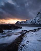 Winter sunser over snow covered coast at Å, Moskenesøy, Lofoten Islands, Norway